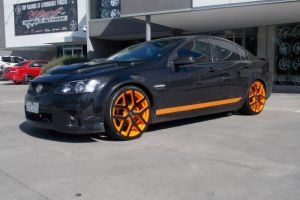 HOLEN WITH ORANGE G8 WHEELS  | HOLDEN